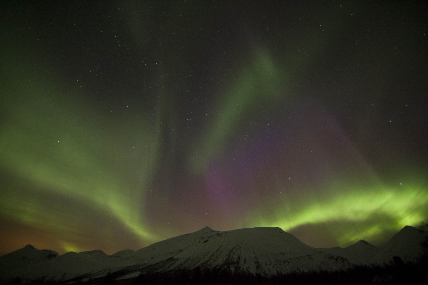 Northern lights above mountains