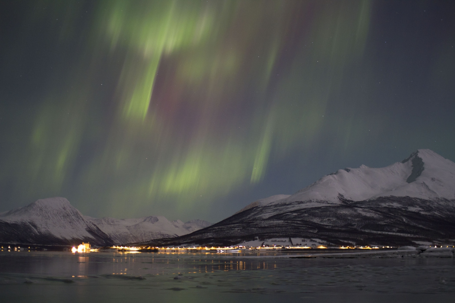 Northern Lights above mountains and sea