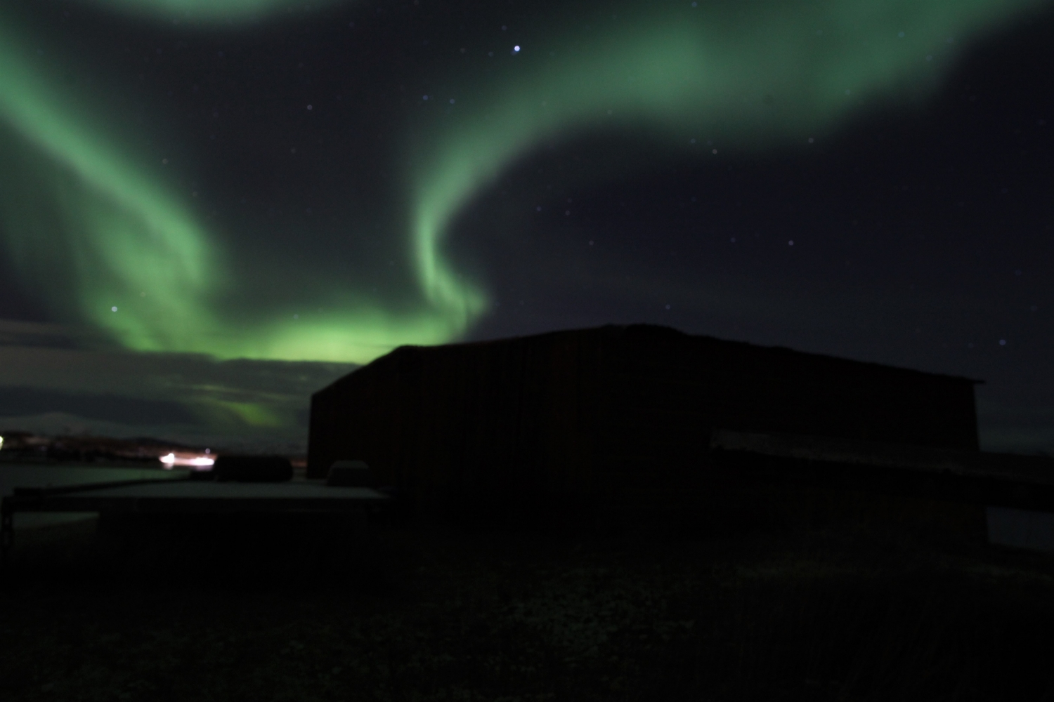 Northern Lights over dark landscape