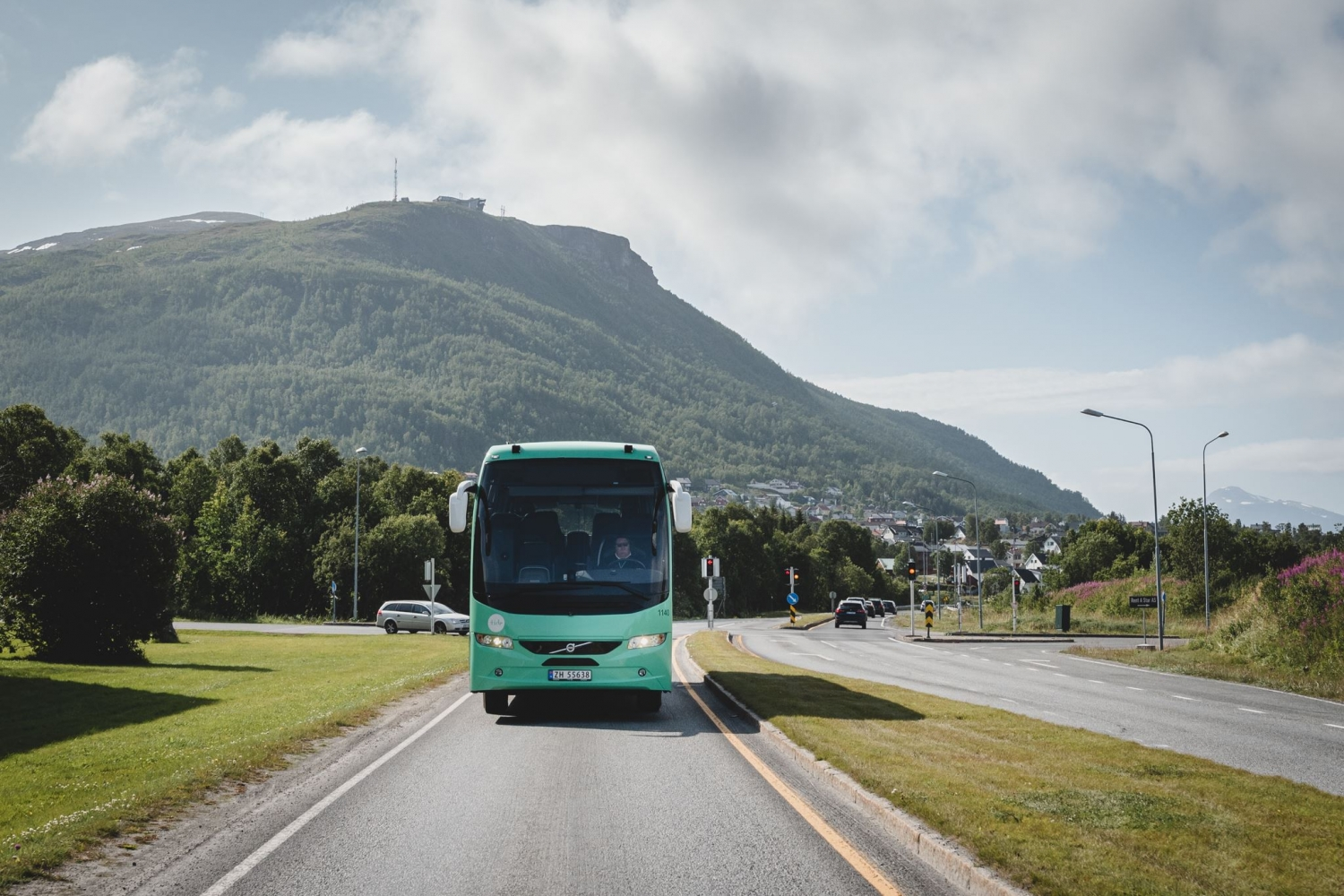 Bus on the road, mountain in the background