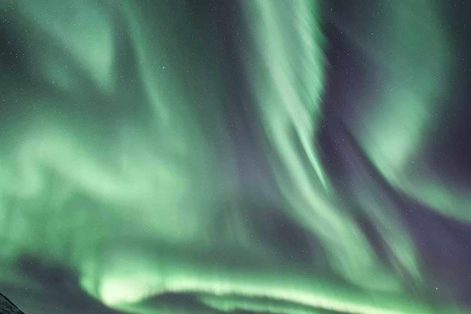 Northern Lights above arctic landscape