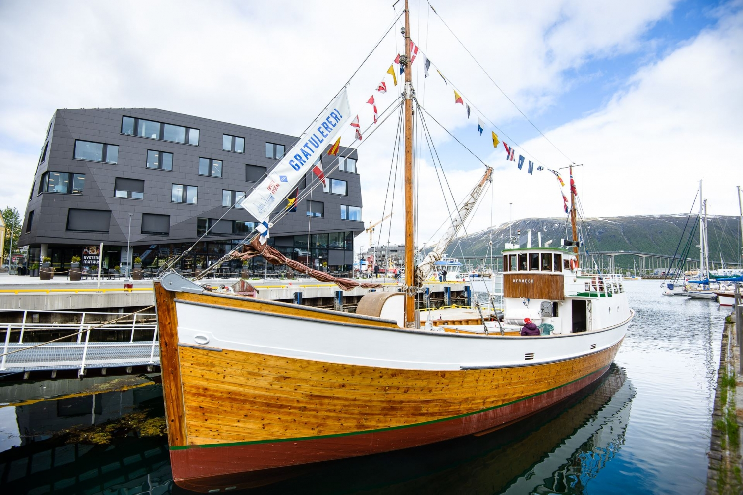 The wooden boat Hermes II by the pier in Tromsø city centre